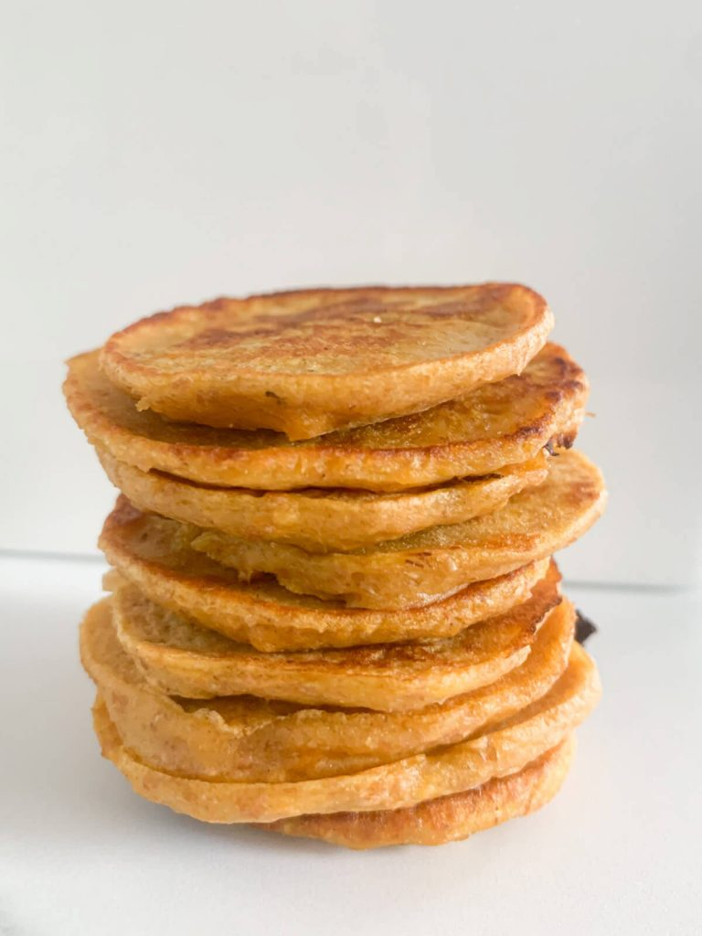 Stack of sweet potato pancakes with white background