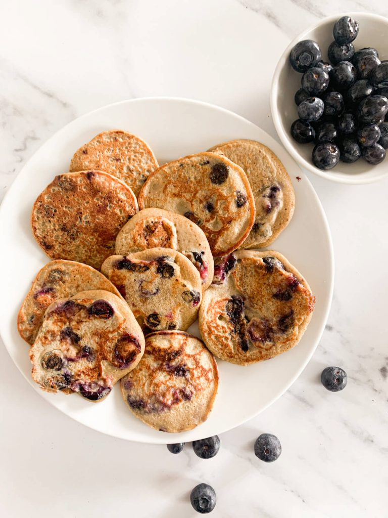 Blueberry Pancakes on a plate with a side of blueberries for baby & toddler