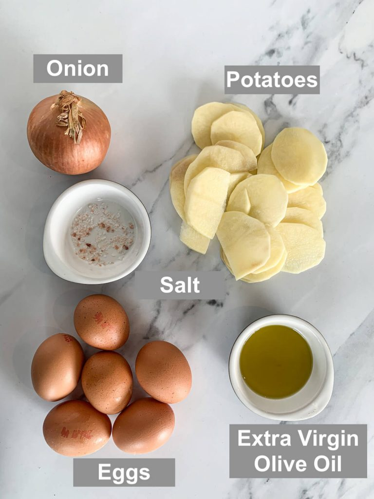ingredients for oven-baked Spanish tortilla - onion, potato, salt, eggs and extra virgin olive oil