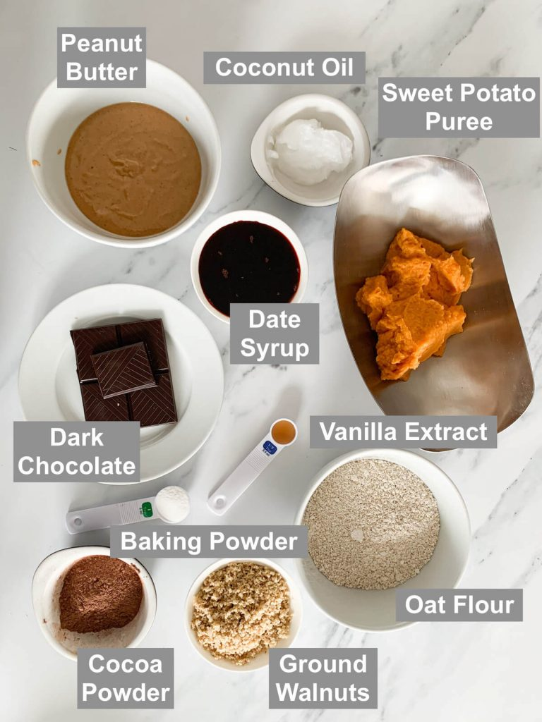 Ingredients for sweet potato brownies on a marble background