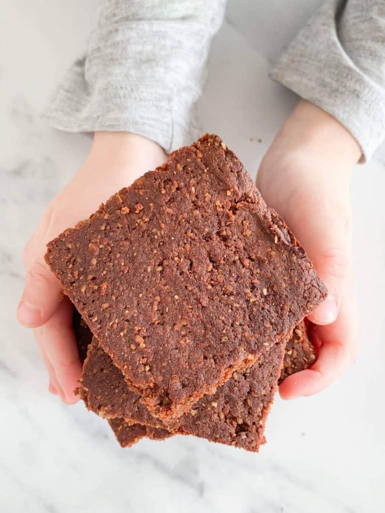Toddler holding brownies