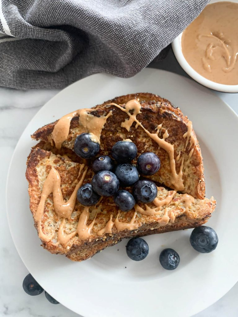 french toast topped with peanut butter and blueberries