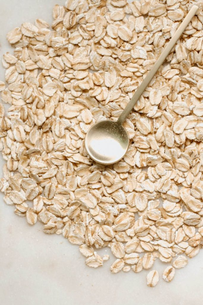 raw oats on white background
